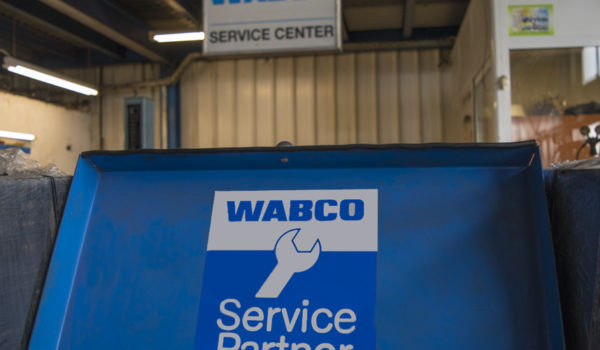 Interior of workshop while open with focus on Wabco Service Partner logo